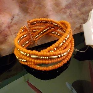 Flexible  bracelet cusp orange 1 of  seasons hits